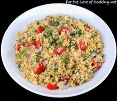 Roasted Garlic Cous Cous with tomatoes, spinach, and onion. great easy summer meal