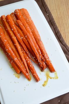 Honey Ginger Roasted Carrots Recipe ~ The honey caramelizes in the oven creating slightly sweetened, perfectly roasted carrots.