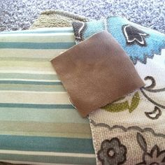 striped fabric I picked up for throw pillows, tan fabric is from the couch, and then on the right the curtain fabric.