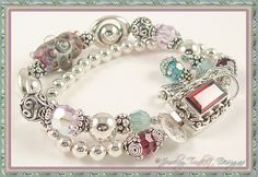 Solid sterling silver double strand bracelet.  Handblown glass lampwork focal, Swarovski crystals, chunky sterling bead frames and fabulous chunky gemstone clasp!