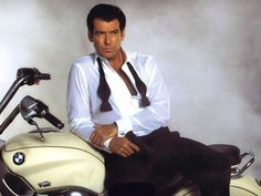 Pierce Brosnan in his TND outfit, sitting on a BMW R1200C - Tomorrow Never Dies