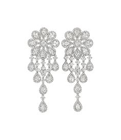 A Pair of Diamond Ear Pendants  Each designed as a cascade of circular and marquise-cut diamonds, suspended from a vari-cut diamond flowerhead surmount, mounted in 18K white gold, length 2 1/2 inches.