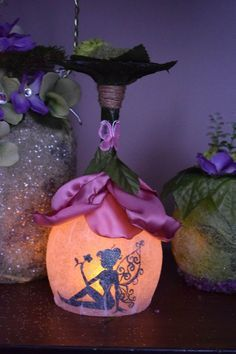 this sale is for 1 fairy lantern flower house beautiful flower decor big flower petals are all individually custom made with satin foliage all around the stem. twine and real natural moss ornate the stem. Custom made fairy house, lantern/ night light. Tea light is included. Do