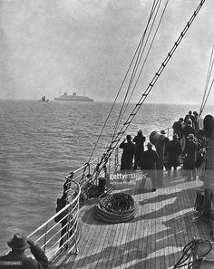 The German Norddeutsche Lloyd liner SS Europa (left) lying off Southampton Harbour, circa 1930.