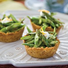 Asparagus tossed in an orange vinaigrette and served in petite crumb cups is a flavorful addition to the tea tray.