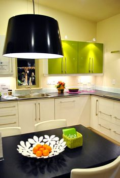 This is a fun idea! Paint just a few cabinets in a bold color. Could be cool for a laundry room, office, etc.