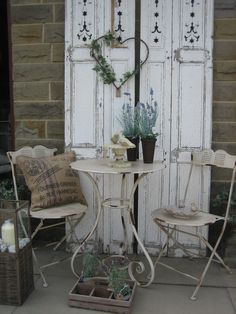 Love the shutters in the garden! Very chic! lookout for brocante to mask gray wall and grow vines up