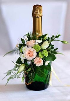 Showstopper floral idea for amping up champagne bottles. Showstopper floral idea for amping up champagne bottles. Showstopper floral idea for amping up… - Floral Centerpieces, Wedding Centerpieces, Wedding Decorations, Centrepiece Ideas, Shower Centerpieces, Champagne Centerpiece, Easter Centerpiece, Wedding Tables, Decor Wedding