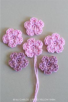 Tutorial for simple crocheted flower - https://helloyellowyarn.com/2016/04/28/simple-crochet-flower-pattern-and-tutorial/