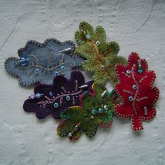 here's one I made earlier: Felt Leaf Brooches--would be great for hats. Felted Wool Crafts, Felt Crafts, Fabric Crafts, Fabric Brooch, Felt Brooch, Brooch Pin, Felt Flowers, Fabric Flowers, Felt Leaves