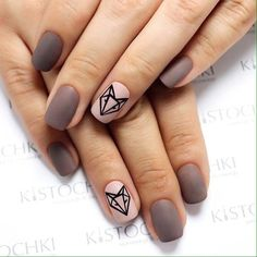 The nail polishes of pale lilac and dark beige hues harmonize splendidly together. They help to create unshowy but stylish manicure. It will be better to make this manicure on the rounded nails of the medium length. To add your nails some effective note, you can create the geometrically checked patt…