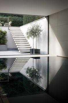 stairs pool reflection courtyard white brick minimal