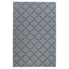 """Anchor your dining set or living room seating group with this hand-loomed wool rug, showcasing a trellis motif in light blue.   Product: RugConstruction Material: 100% WoolColor: Light blueFeatures:  Hand-loomed0.5"""" Pile height Note: Please be aware that actual colors may vary from those shown on your screen. Accent rugs may also not show the entire pattern that the corresponding area rugs have.Cleaning and Care: Vacuum regularly. Spot cleaning recommended. Rug pad recommended for use on ..."""