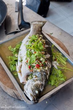 Pla kapong neung manao (ปลากะพงนึ่งมะนาว) - Try this recipe for Thai style steamed barramundi fish with lime, garlic, and chili!