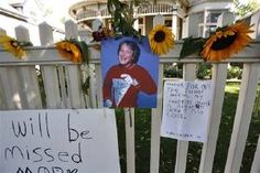 A photo of the late actor Robin Williams playing Mork from Ork hangs with flowers and notes left by people paying their respects, at a makeshift  memorial in Boulder, Colo., Tuesday Aug. 12, 2014, outside the home where the 80s TV series Mork & Mindy, starring Williams, was set. Williams, the Academy Award winner and comic supernova whose explosions of pop culture riffs and impressions dazzled audiences for decades and made him a gleamy-eyed laureate for the Information Age, died Monday, ...