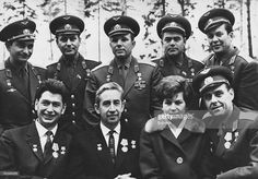 The cosmonauts of the Russian spacecraft Voskhod 1 are given a welcome reception by their fellow space pioneers at Zvyozdny, 30th October 1964. From left to right, (back row) Valery Bykovsky, Gherman Titov (1935 - 2000), Yuri Gagarin (1934 - 1968), Andriyan Nikolayev (1929 - 2004) and Pavel Popovich (1930 - 2009); (front row) Boris Yegorov (1937 - 1994), Konstantin Petrovich Feoktistov (1926 - 2009), Valentina Tereshkova and Vladimir Mikhaylovich Komarov (1927 - 1967). The three men in the…