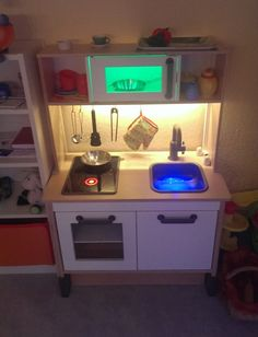 For my daughter I pimped the IKEA DUKTIG children kitchen. Now the water-tap has a light and sound effect. Also the microwave and oven are equipped with a LEDs and sound effects. A Raspberry Pi controls the kitchen. The whole electronic is mounted on bottom of the kitchen, e.g. power supply, loud speaker. Hacking a [&hellip