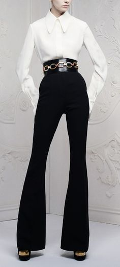 I have pinned a similar outfit before... Black heels, black pants and white blouse. Very easy, sophisticated work look. It can be combined with either a statement necklace or, just like in this pic, with a statement belt. No-brainer. Always wear with tied back hair.