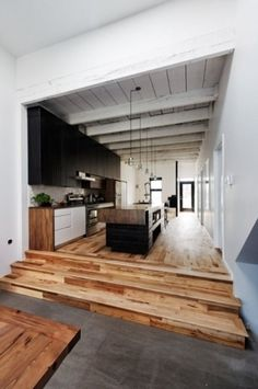 Unique kitchen - love the timber flooring.