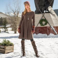 """WOODLAND HILLS DRESS--A shameless flatterer, this swing shape dress in a comforting, lambswool blend has radiating cables and a flared skirt for a classic silhouette. Lambswool/nylon. Hand wash. Imported. Exclusive. Sizes XS (2), S (4 to 6), M (8 to 10), L (12 to 14), XL (16). Approx. 37""""L."""
