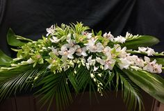 Casket spray mix foliage and orchids   Tommy Austin florist  909/948-9098