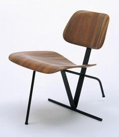 Charles and Ray Eames; Molded Walnut Plywood and Enameled Steel 'Tilt-Back' Side Chair for Evans Products Co., c1944.