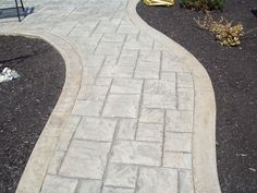Stamped concrete patterns patio: A lot of furniture or accessories can produce a room feel cramped. A greater option is to set only a few select bits of furnishings with clean lines these clear up additional space. Slate Walkway, Stamped Concrete Walkway, Gravel Walkway, Concrete Path, Concrete Patio Designs, Front Walkway, Concrete Texture, Front Yard Landscaping, Backyard Patio