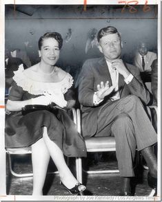 """July 11, 1960: In the photo above, Sen. John F. Kennedy (D-Mass.) tells photographer Joe Kennedy """"No pictures, please"""" while sitting with Vel Phillips on July 10, 1960. The photo was taken during a rally at Shrine Auditorium led by the Rev. Martin Luther King Jr. urging a civil rights plank in the Democratic platform. This is probably the most interesting photo in the entire Times folder on the convention because it captures Kennedy when he assumed he was out of the political spotlight"""