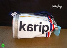 """Marine Bag Brisot-X X-332 (H65 x r35) This bag is made of two sailcloth. One is from Genoa furling boat Bavaria 38 """"Magic"""" 2003. The Genoa has """"decommissioned"""" in 2008. It has been estimated that the miles that sail is about 7800-8000 nm The second is from cloth by mylar kevlar mainsail BOARD Brisot-X X-332. #sailsbags"""