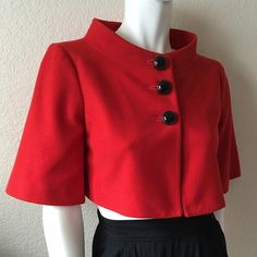 Forever 21 Cropped Jacket Forever 21 Cropped Jacket comes in a red-orange color, is fully lined with three front button closure. Size: M Shell: 100% Polyester Lining: 100% Cotton. In excellent condition. Forever 21 Jackets & Coats Capes