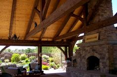 Showing the large fire place inside the timber frame Outdoor kitchen