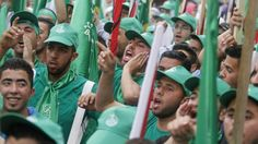 Palestinian supporters of the Islamist Hamas movement attend a rally at Birzeit University, on the outskirts of the West Bank city of Ramallah, on May 6, 2014. (Issam Rimawi/Flash90)