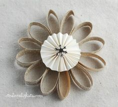 Turn old book pages into an ornament or gift wrapping embellishment