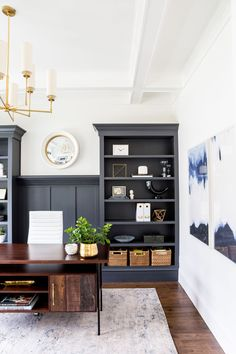 Dark Home Office Inspiration and Ideas, home office design with navy buillt in bookcases and rustic wood desk, gold chandelier in home office Home Office Design, Home Office Decor, Home Decor, Office Furniture, Masculine Office Decor, Navy Furniture, Home Office Colors, Dresser Furniture, Office Rug