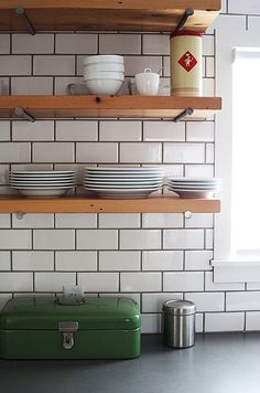 white subway tile with dark grout maybe not so thick and a lighter gray??
