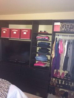 Handmade closet organizer. It cost less then $130.00 to make this whole thing. Great for little closet in bedroom with no space. I used two dresser and built around them. It made a big difference in my room