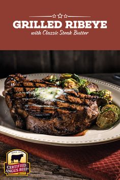 """Grilled Ribeye with Classic Steak Butter - Place a pat of this tasty herb butter on each sizzling steak while it rests. The butter will slowly melt over the top. It's an added layer of amazing """"steakhouse"""" flavor on a truly remarkable steak."""