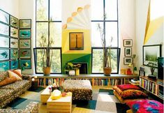 Todd Oldham's living room. Bench bookshelves.