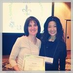 Dr. Hunt receiving her research travel award with her mentor Dr. Song.