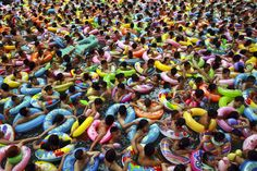 In this Sunday Aug. 19, 2012 photo, people cool down in a swimming pool in Daying county, in southwestern China's Sichuan province. (AP Photo)