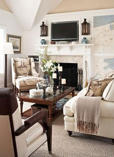 Nice casual room. Love the maps on the wall, LOOVE the sconces, barley twist lamp....Built in TV fits in well.