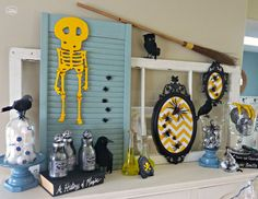 Thrifty Halloween Mantel with yellow wooden skeleton at thehappyhousie