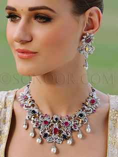 NEC/1/3555 Aurvi Necklace Set with Earrings in silver rhodium finish studded with cubic zircons, iolite, rubies, and hanging pearl droplets