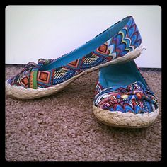 Flats Super cute and trendy multi-colored and multi-design flats. Two straps with knots layer over toes. Straw-like material around bottom of shoes. Only worn a couple times. Blowfish Shoes Flats & Loafers