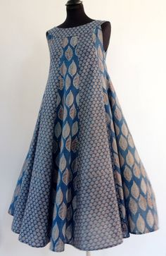 Mid long dress with blue block printed cotton print sleeveless round neck pieces. Kurta Designs Women, Blouse Designs, Sleeve Designs, African Wear, African Dress, Casual Dresses, Short Dresses, Frocks For Girls, Pakistani Dress Design