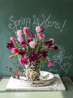 A pretty spring floral arrangement in a pussy willow vase. Perfect for an Easter decoration.