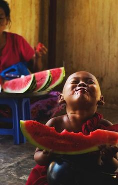 watermelon - Yeah, I feel that way too while enjoying a cold, ripe watermelon with the outside temperature hovering around 100 degrees and I'd just eaten the best hamburger ever cooked. This kid knows the feelin'
