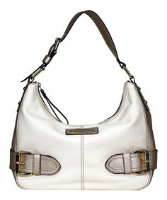 A curvy hobo that keeps the slouch to a minimum, this gorgeous leather bag features attractive belt accents with metallic buckles. The roomy, zip-closed interior is organized by two wall slip pockets and the single strap offers several inches of adjustability for customized carrying.12.25'' W x 10.5'' H x 4'' D11.5'' shoulder dropLeatherImported