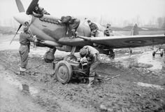 Atrocious weather in the winter of 1944 turned airfields in Belgium and the Netherlands into quagmires. This No 127 Squadron Spitfire XVIE (RR255/9N-Y) has its daily inspection in a sea of mud at Grimbergen (B-60), 9 December. Even the starter trolley in the foreground is receiving attention in this heavily posed scene. The 'E' wing fitted to Spitfire XVIs and later Mk IXs finally did away with the four rifle-calibre machine-guns, replacing them with a pair of .50in Brownings.
