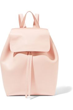 Mansur Gavriel focus on soft colors and beautiful materials. This pretty pastel-pink backpack has been crafted in Italy from matte-leather. Sized to fit just the essentials, it's unlined to maximize the minimalist aesthetic but has a small zipped pocket for cards.